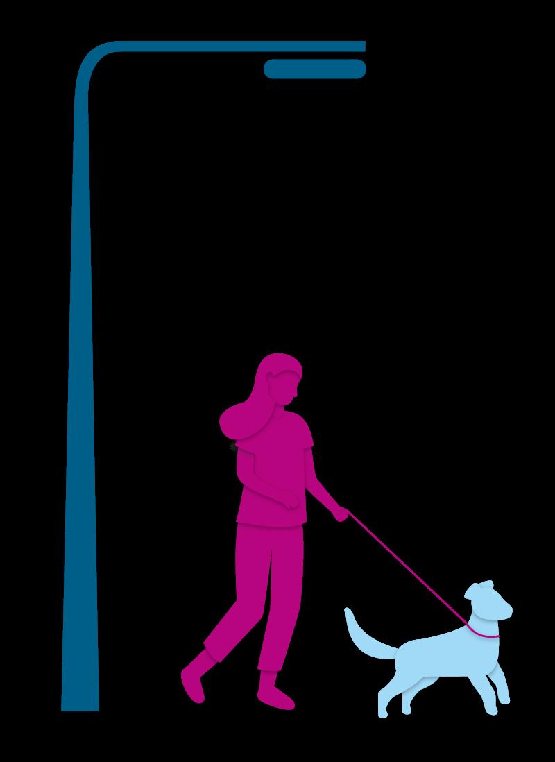 Frau unter einer Laterne mit einem Hund